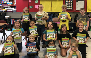 Third Graders receive Dictionaries
