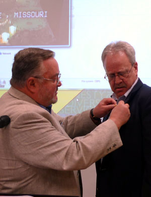 Pat Roll receives member pin.